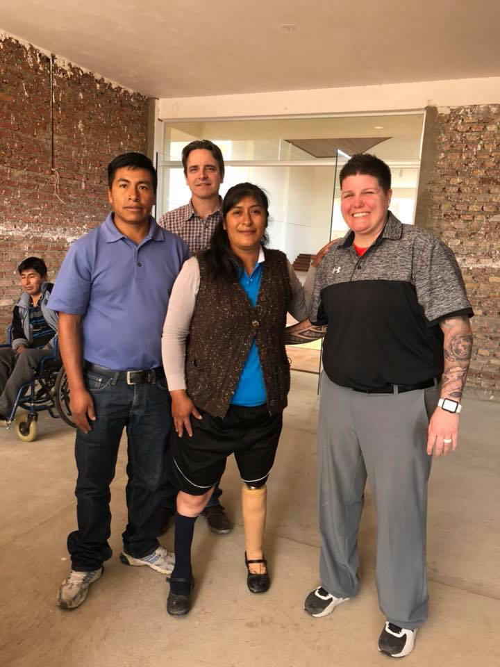 JJC student Alisha Brennon with amputee that she helped walk again in Bolivia.
