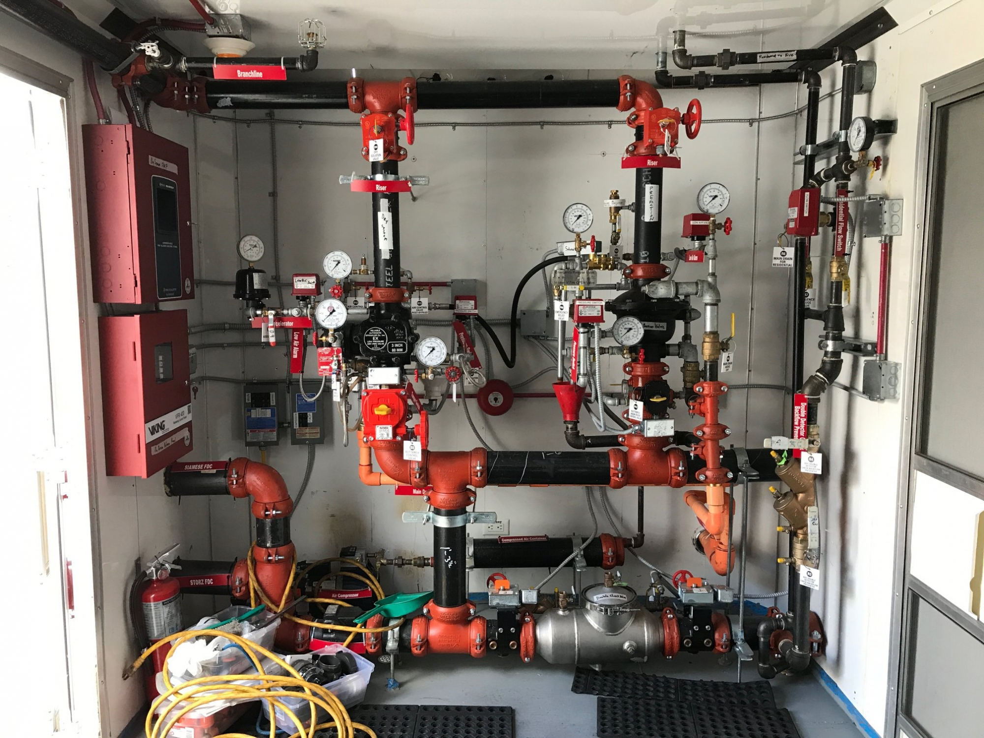 The trailer interior features many types of sprinkler systems that the students will encounter upon entering the profession. It also has a controlled burn room.