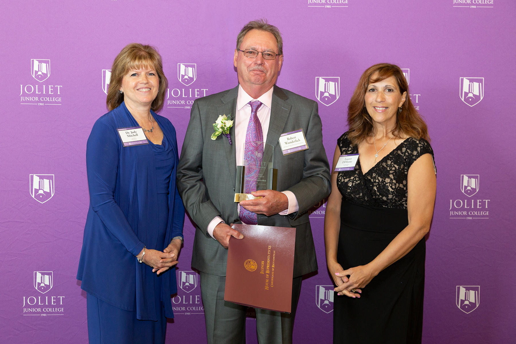 From left: JJC President Dr. Judy Mitchell, Robert Wunderlich (Susan H. Wood Hall of Fame Award recipient), JJC Alumni Board Member Luann Di Monte