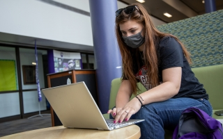 A student is on her laptop, applying for a scholarship
