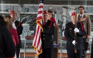 veterans holding flag