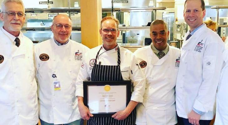 Chef Tim Bucci holding CMC certificate