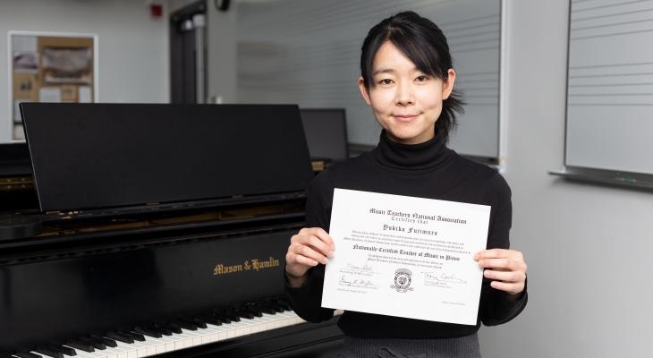 Yukiko Fujimura holding MTNA certificate