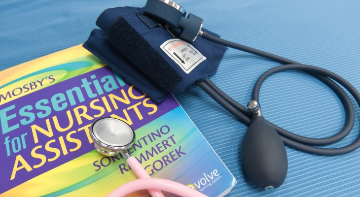 nursing book and stethoscope