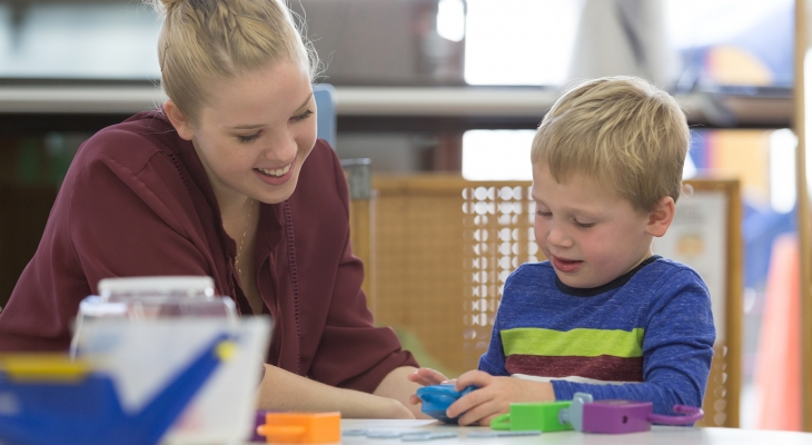 student working with child in ECC